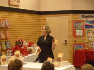 Tina Ann Forkner speaking to the audience at the Cheyenne B&N Release party.